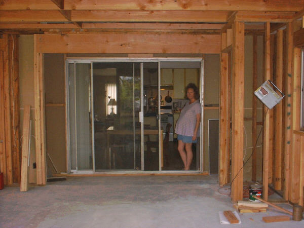 Room addition, 6-19: This photo looks in from the new patio door past the old patio door opening, past the temporary wall (with the old patio door inserted for light and access), to the kitchen.