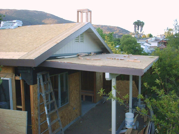 Room addition, 6-28: This photo shows the new patio roof and how it ties in with the peaked roof of the addition. Note the chimney framing.