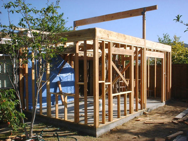 Room addition, 6-5: The walls are now up, and the beam to carry the roof is in place.
