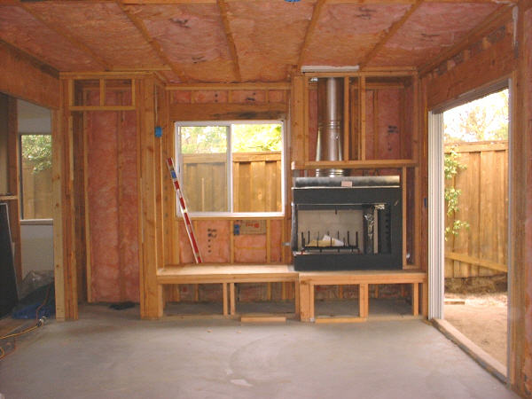 Room addition, 7-10: This photo shows the two-sided corner fireplace, and also the insulation.