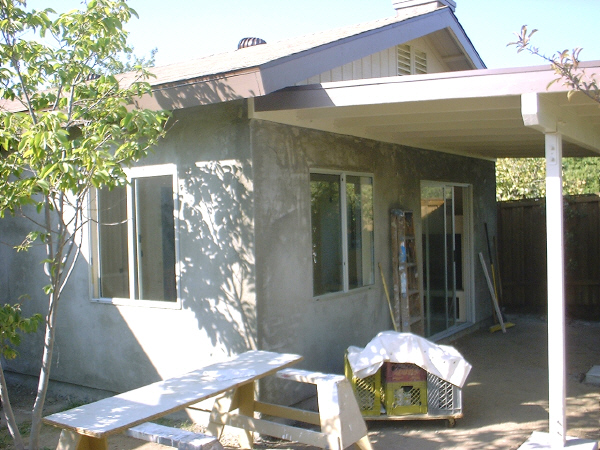Room addition, 8-21: This photo shows the second of three coats of stucco, called the brown coat.